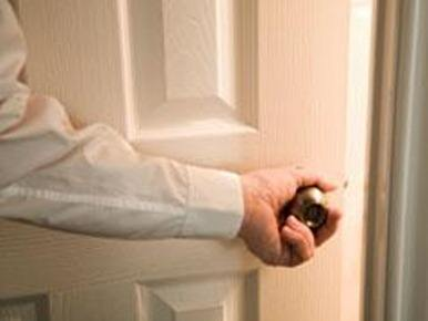 man-closing-door
