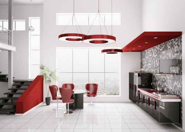 Cocinas negras y rojas con mesa