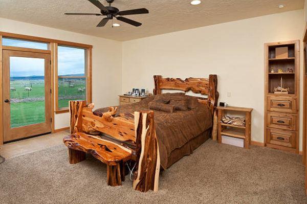 Como decorar con troncos de madera cama rustica